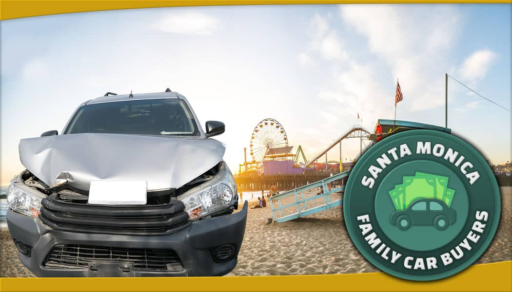 grey suv with Santa Monica pier in the background along with official FCB service area emblem