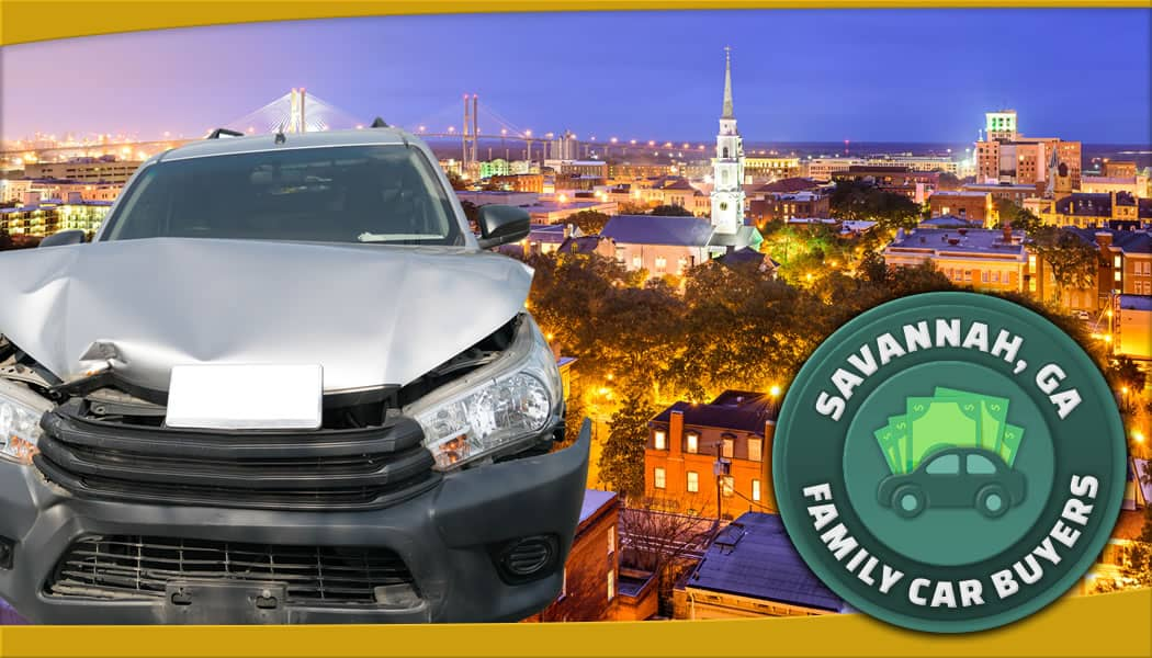 Damaged grey SUV with aerial photo of Savannah along with official FCB service area emblem